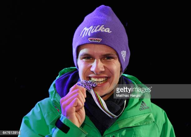 Silver medalist Andreas Wellinger of Germany celebrates during the medal ceremony for the Men's Ski Jumping HS130 at the FIS Nordic World Ski...