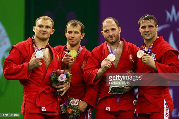 Silver medalist Andrei Kazusionak of Belarus gold medalist Alsim Chernoskulov of Russia and bronze medalists Davit Karbelashvili of Georgia and...
