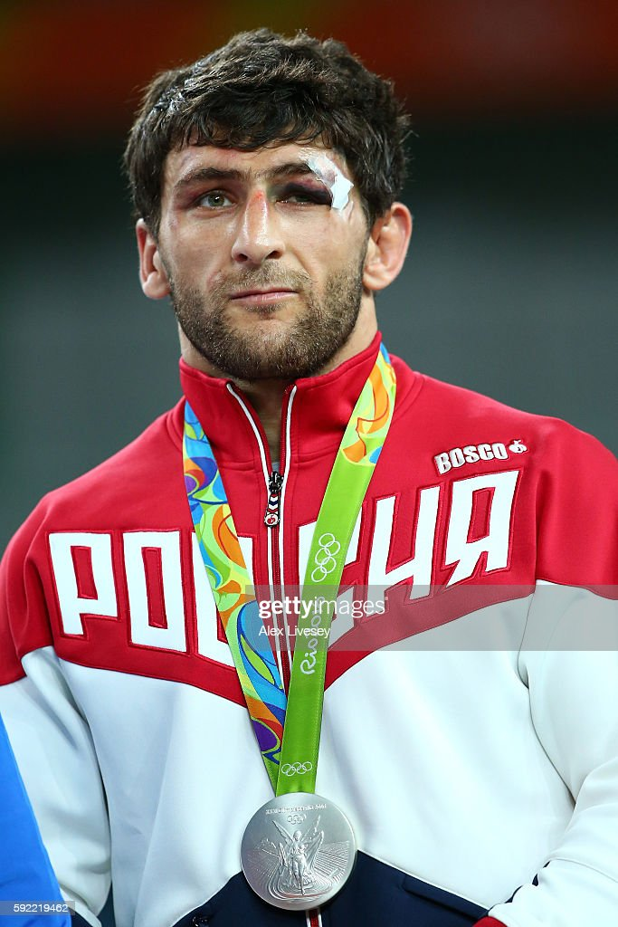 Silver medalist, Aniuar Geduev of Russia celebrates on the podium during the medals ceremony after the Men's 74kg Wrestling match on Day 14 of the Rio 2016 Olympic Games at Carioca Arena 2 on August 19, 2016 in Rio de Janeiro, Brazil.