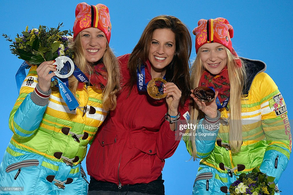 Silver medalist Anke Karstens of Germany, gold medalist <a gi-track='captionPersonalityLinkClicked' href=/galleries/search?phrase=Julia+Dujmovits&family=editorial&specificpeople=4698927 ng-click='$event.stopPropagation()'>Julia Dujmovits</a> of Austria and bronze medalist <a gi-track='captionPersonalityLinkClicked' href=/galleries/search?phrase=Amelie+Kober&family=editorial&specificpeople=869316 ng-click='$event.stopPropagation()'>Amelie Kober</a> of Germany celebrate during the medal ceremony for the Snowboard Ladies' Parallel Slalom on Day 15 of the Sochi 2014 Winter Olympics at Medals Plaza on February 22, 2014 in Sochi, Russia.
