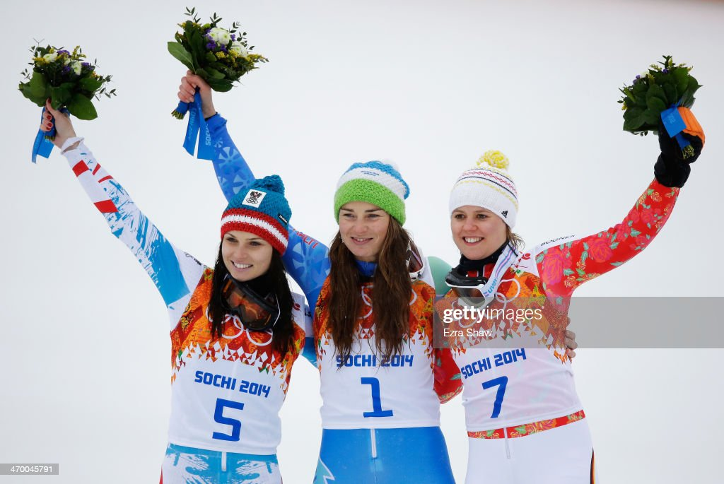Silver medalist <a gi-track='captionPersonalityLinkClicked' href=/galleries/search?phrase=Anna+Fenninger&family=editorial&specificpeople=4045781 ng-click='$event.stopPropagation()'>Anna Fenninger</a> of Austria, gold medalist <a gi-track='captionPersonalityLinkClicked' href=/galleries/search?phrase=Tina+Maze&family=editorial&specificpeople=213514 ng-click='$event.stopPropagation()'>Tina Maze</a> of Slovenia and bronze medalist <a gi-track='captionPersonalityLinkClicked' href=/galleries/search?phrase=Viktoria+Rebensburg&family=editorial&specificpeople=4152387 ng-click='$event.stopPropagation()'>Viktoria Rebensburg</a> of Germany celebrate on the podium during the flower ceremony for the Alpine Skiing Women's Giant Slalom on day 11 of the Sochi 2014 Winter Olympics at Rosa Khutor Alpine Center on February 18, 2014 in Sochi, Russia.