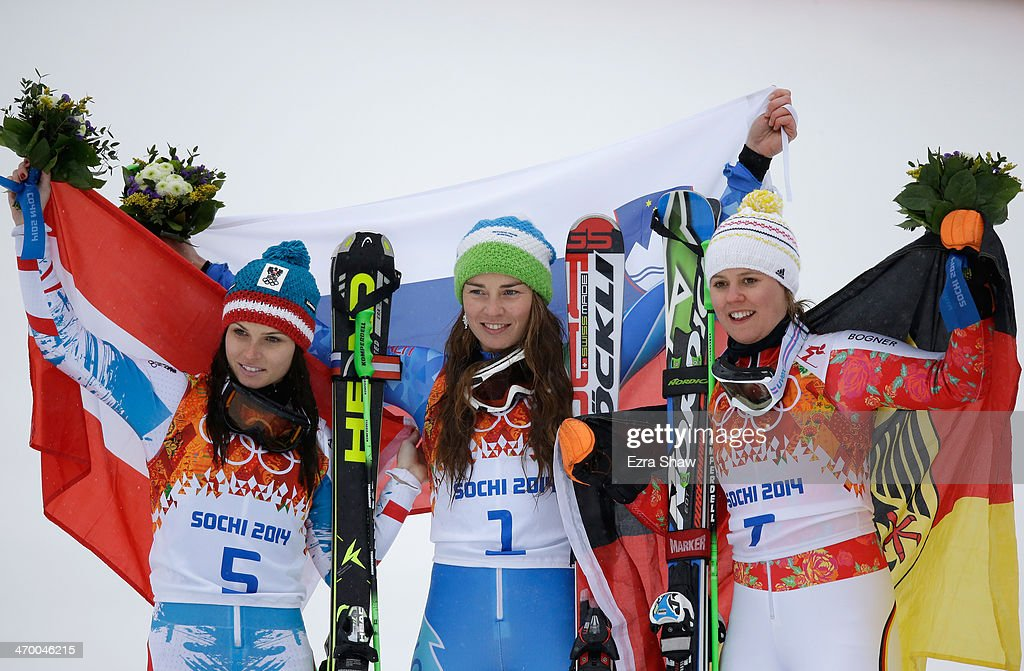 Silver medalist Anna Fenninger of Austria, gold medalist Tina Maze of Slovenia and bronze medalist Viktoria Rebensburg of Germany celebrate on the podium during the flower ceremony for the Alpine Skiing Women's Giant Slalom on day 11 of the Sochi 2014 Winter Olympics at Rosa Khutor Alpine Center on February 18, 2014 in Sochi, Russia.
