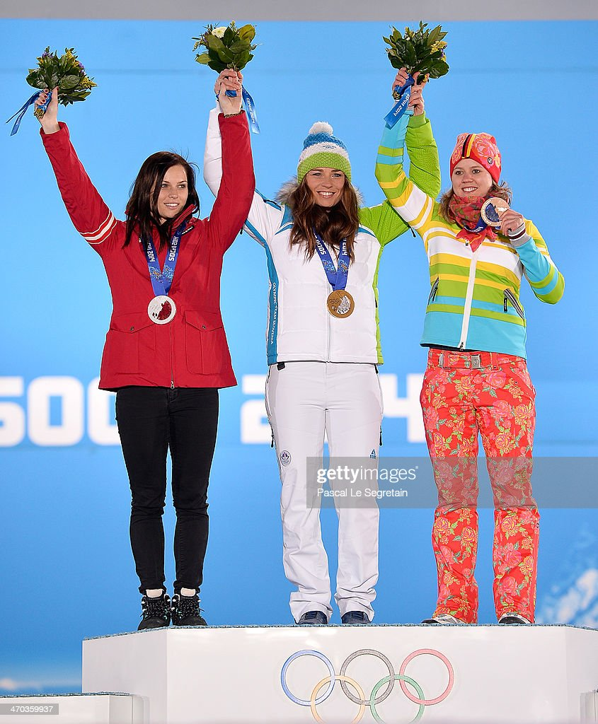 Silver medalist <a gi-track='captionPersonalityLinkClicked' href=/galleries/search?phrase=Anna+Fenninger&family=editorial&specificpeople=4045781 ng-click='$event.stopPropagation()'>Anna Fenninger</a> of Austria, gold medalist <a gi-track='captionPersonalityLinkClicked' href=/galleries/search?phrase=Tina+Maze&family=editorial&specificpeople=213514 ng-click='$event.stopPropagation()'>Tina Maze</a> of Slovenia and bronze medalist <a gi-track='captionPersonalityLinkClicked' href=/galleries/search?phrase=Viktoria+Rebensburg&family=editorial&specificpeople=4152387 ng-click='$event.stopPropagation()'>Viktoria Rebensburg</a> of Germany celebrate on the podium during the medal ceremony for the Women's Giant Slalom on day twelve of the Sochi 2014 Winter Olympics at at Medals Plaza on February 19, 2014 in Sochi, Russia.