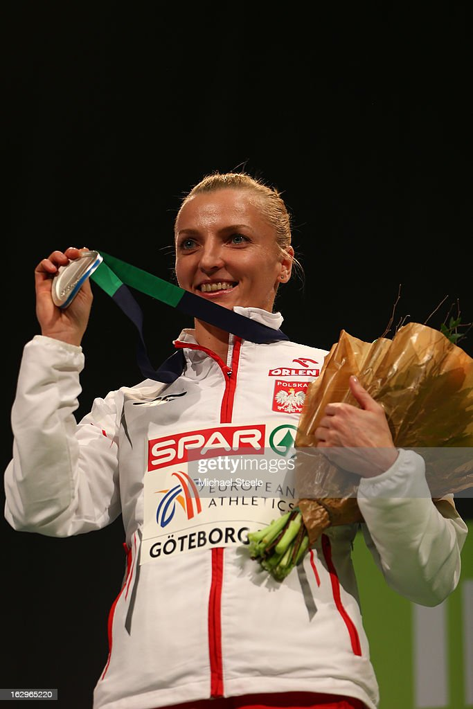 Silver medalist <a gi-track='captionPersonalityLinkClicked' href=/galleries/search?phrase=Anna+Rogowska&family=editorial&specificpeople=790729 ng-click='$event.stopPropagation()'>Anna Rogowska</a> of Poland poses during the victory ceremony for the Women's Pole Vault during day two of the European Athletics Indoor Championships at Scandinavium on March 2, 2013 in Gothenburg, Sweden.
