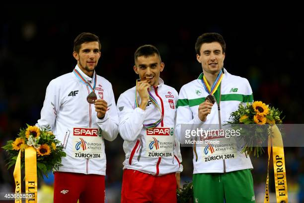 Silver medalist Artur Kuciapski of Poland gold medalist Adam Kszczot of Poland and bronze medalist Mark English of Ireland stand on the podium during...