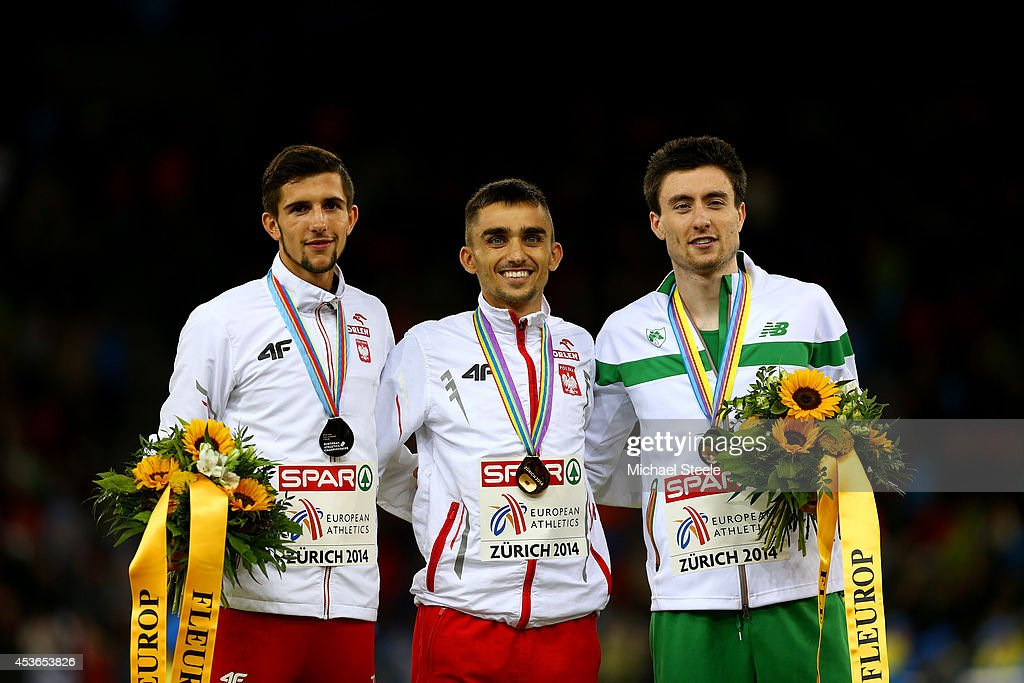 Silver medalist Artur Kuciapski of Poland, gold medalist <a gi-track='captionPersonalityLinkClicked' href=/galleries/search?phrase=Adam+Kszczot&family=editorial&specificpeople=5746296 ng-click='$event.stopPropagation()'>Adam Kszczot</a> of Poland and bronze medalist Mark English of Ireland stand on the podium during the medal ceremony for the Men's 800 metres final during day four of the 22nd European Athletics Championships at Stadium Letzigrund on August 15, 2014 in Zurich, Switzerland.