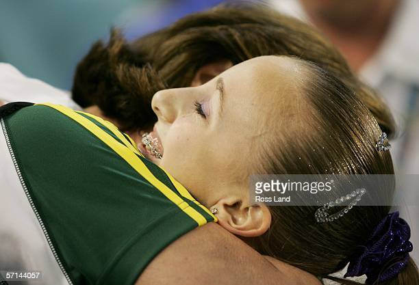 SIlver medalist Ashleigh Brennan of Australia is congratulated after the Women's Floor Final in the artistic gymnastics at the Rod Laver Arena during...