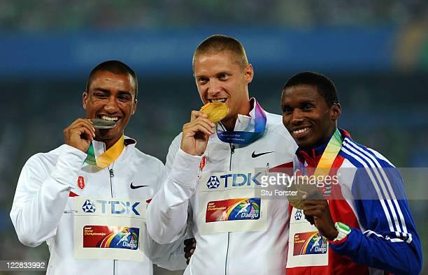 Silver medalist Ashton Eaton of United States gold medalist Trey Hardee of United States and Leonel Suarez of Cuba celebrate on the podium with their...
