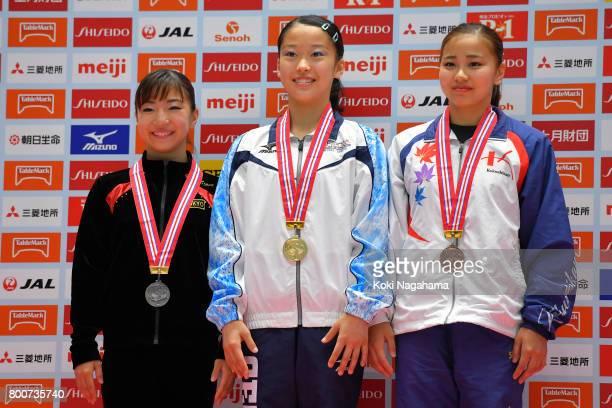 Silver medalist Asuka Teramoto Gold medalist Hitomi Hatada and Bronz medalist Yuriko Yamamoto pose for photographs on the podium in the award...