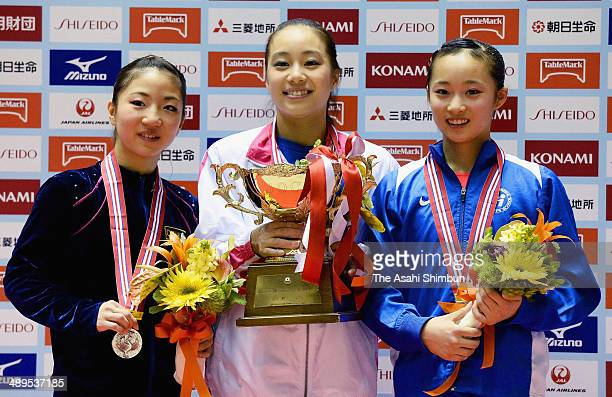 Silver medalist Asuka Teramoto gold medalist Natsumi Sasada and bronze medalist Yuna Hiraiwa pose for photographs on the podium during day three of...
