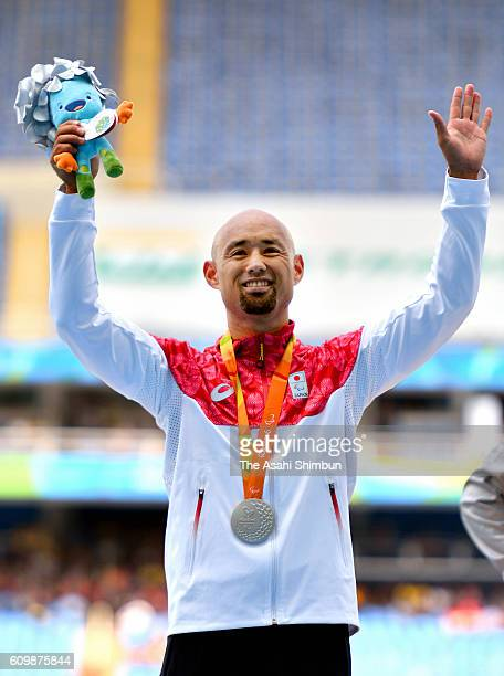 Silver medalist Atsushi Yamamoto of Japan celebrates on the podium at the medal ceremony for the Men's Long Jump T42 on day 10 of the Rio 2016...