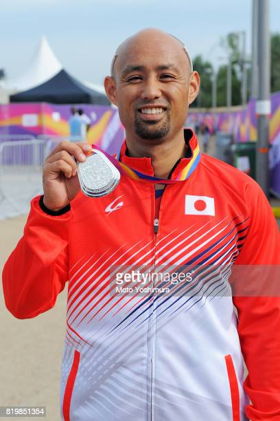 Silver medalist Atsushi Yamamoto of Japan poses for photographs after the medal ceremony for the Men's Long Jump T42 during day five of the IPC World...