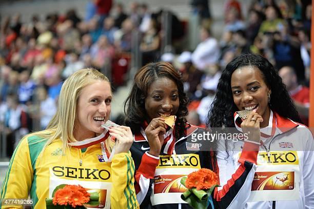Silver medalist Australia's Sally Pearson gold winner US Nia Ali and bronze medalist Great Britain's Tiffany Porter celebrate on the podium of the...