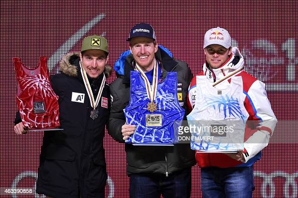 Silver medalist Austria's Marcel Hirscher gold medalist US skier Ted Ligety and bronze medalist France's Alexis Pinturault pose during the medal...