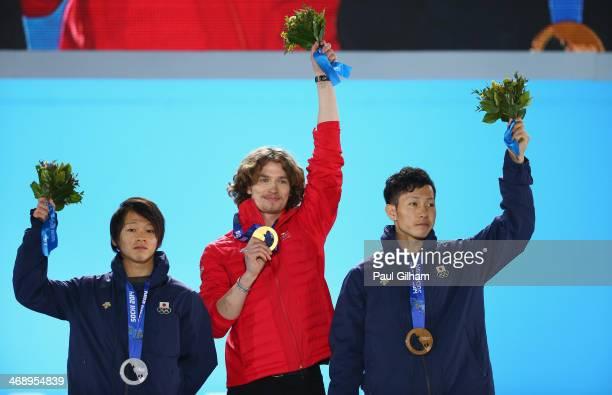 Silver medalist Ayumu Hirano of Japan gold medalist Iouri Podladtchikov of Switzerland and bronze medalist Taku Hiraoka of Japan celebrate on the...