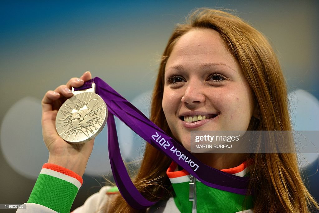 silver medalist Belarus's <a gi-track='captionPersonalityLinkClicked' href=/galleries/search?phrase=Aliaksandra+Herasimenia&family=editorial&specificpeople=2077479 ng-click='$event.stopPropagation()'>Aliaksandra Herasimenia</a> poses with her medal after winning the women's 50m freestyle final during the swimming event at the London 2012 Olympic Games on August 4, 2012 in London.