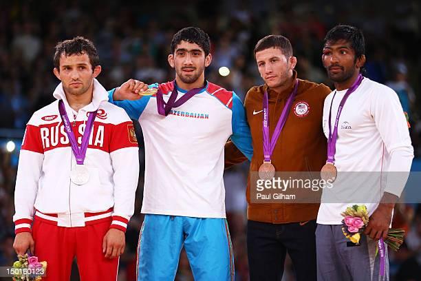 Silver medalist Besik Kudukhov of Russia Gold medalist Toghrul Asgarov of Azerbaijan Bronze medalist Coleman Scott of the United States and Bronze...