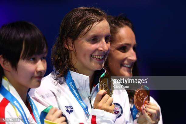 Silver medalist Bingjie Li of China gold medalist Katie Ledecky of the United States and bronze medalist Leah Smith of the United States pose with...