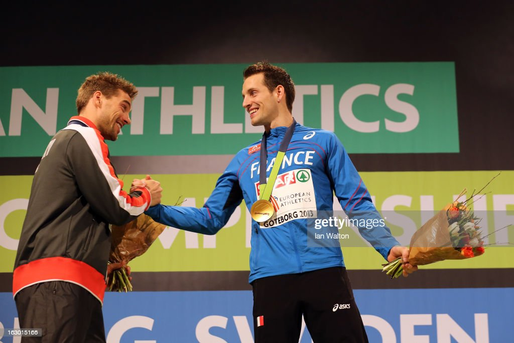 Silver medalist <a gi-track='captionPersonalityLinkClicked' href=/galleries/search?phrase=Bjorn+Otto&family=editorial&specificpeople=2543892 ng-click='$event.stopPropagation()'>Bjorn Otto</a> of Germany congratulates Gold medalist Renaud Lavillenie of France during the victory ceremony for the Men's Pole Vault during day three of European Indoor Athletics at Scandinavium on March 3, 2013 in Gothenburg, Sweden.
