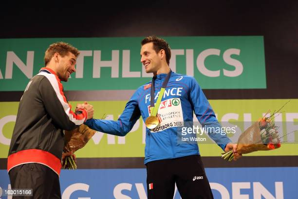 Silver medalist Bjorn Otto of Germany congratulates Gold medalist Renaud Lavillenie of France during the victory ceremony for the Men's Pole Vault...