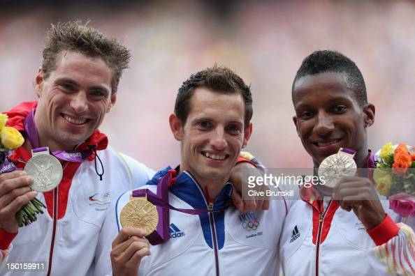 Silver medalist Bjorn Otto of Germany gold medalist Renaud Lavillenie of France and bronze medalist Raphael Holzdeppe of Germany pose on the podium...
