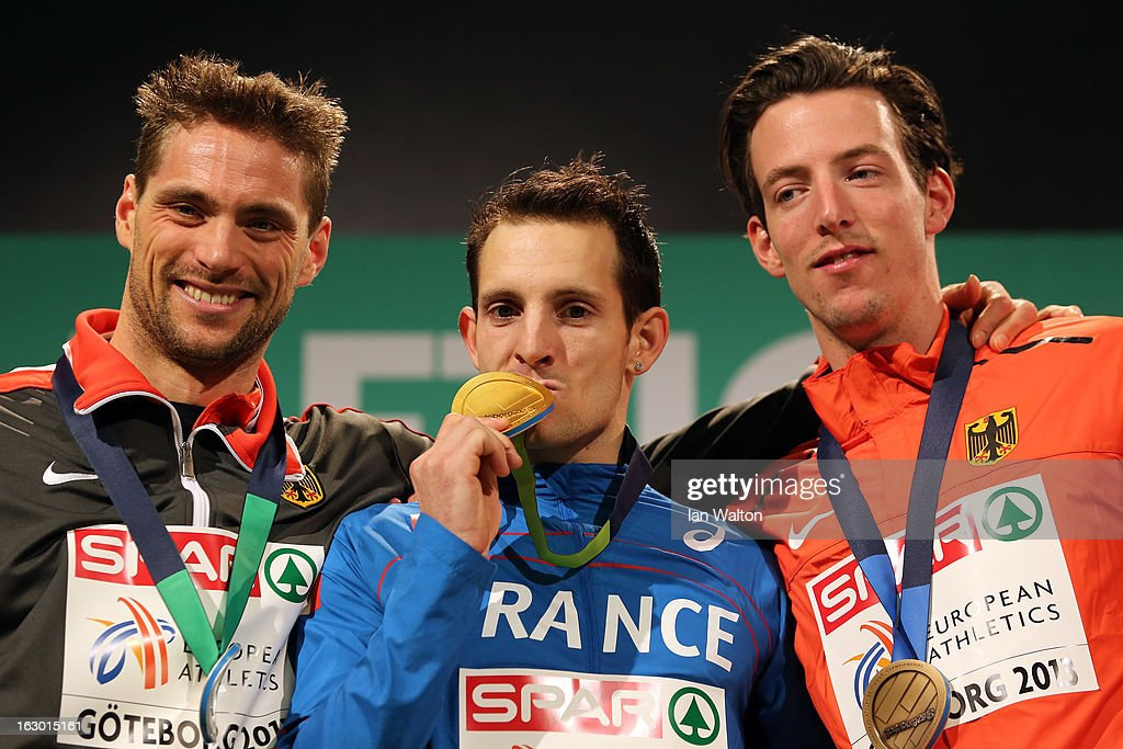 Silver medalist <a gi-track='captionPersonalityLinkClicked' href=/galleries/search?phrase=Bjorn+Otto&family=editorial&specificpeople=2543892 ng-click='$event.stopPropagation()'>Bjorn Otto</a> of Germany, Gold medalist Renaud Lavillenie of France and <a gi-track='captionPersonalityLinkClicked' href=/galleries/search?phrase=Malte+Mohr&family=editorial&specificpeople=5517776 ng-click='$event.stopPropagation()'>Malte Mohr</a> of Germany pose during the victory ceremony for the Men's Pole Vault during day three of European Indoor Athletics at Scandinavium on March 3, 2013 in Gothenburg, Sweden.