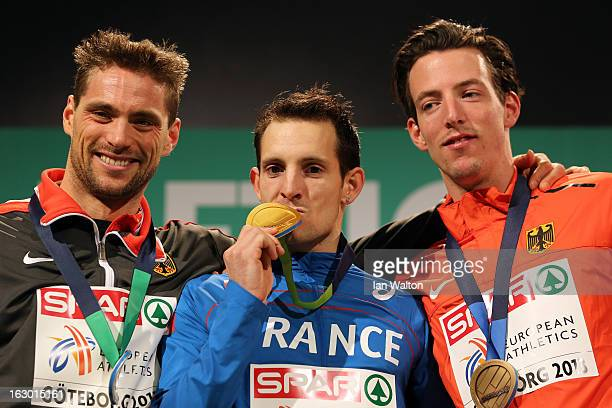 Silver medalist Bjorn Otto of Germany Gold medalist Renaud Lavillenie of France and Malte Mohr of Germany pose during the victory ceremony for the...