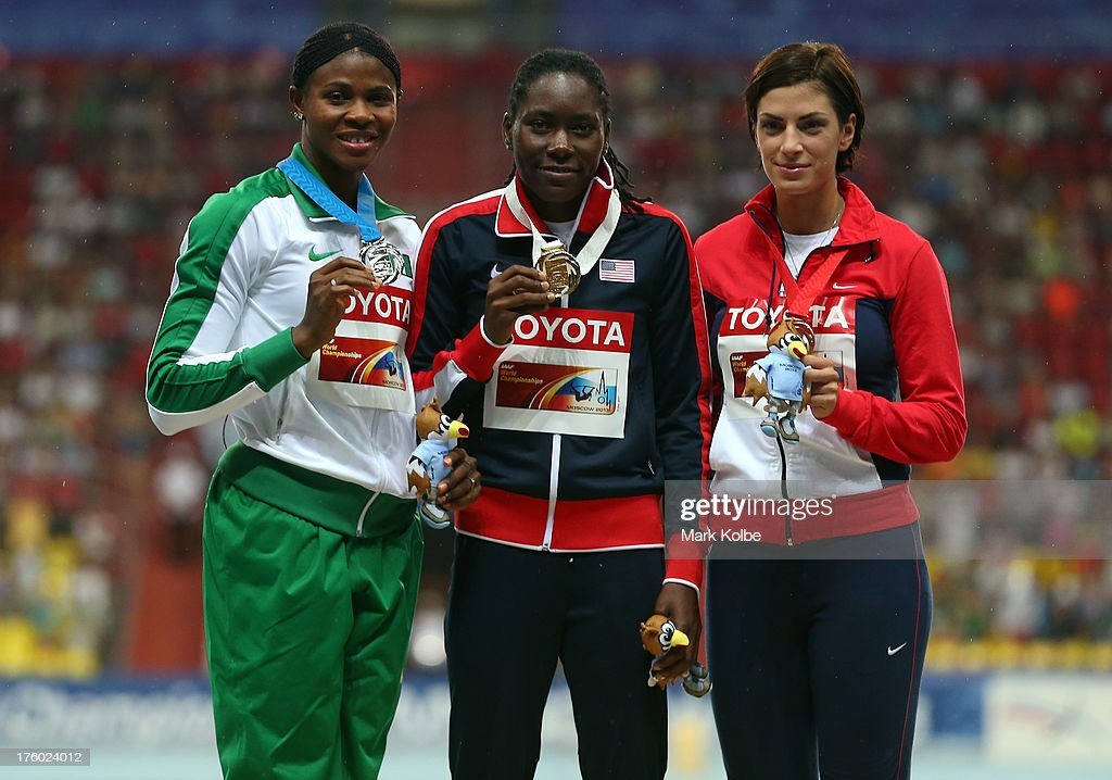 Silver medalist <a gi-track='captionPersonalityLinkClicked' href=/galleries/search?phrase=Blessing+Okagbare&family=editorial&specificpeople=5496695 ng-click='$event.stopPropagation()'>Blessing Okagbare</a> of Nigeria, gold medalist <a gi-track='captionPersonalityLinkClicked' href=/galleries/search?phrase=Brittney+Reese&family=editorial&specificpeople=4362432 ng-click='$event.stopPropagation()'>Brittney Reese</a> of the United States and bronze medalist <a gi-track='captionPersonalityLinkClicked' href=/galleries/search?phrase=Ivana+Spanovic&family=editorial&specificpeople=2261221 ng-click='$event.stopPropagation()'>Ivana Spanovic</a> of Serbia stand on the podium during the medal ceremony for competes in the Women's Long Jump final during Day Two of the 14th IAAF World Athletics Championships Moscow 2013 at Luzhniki Stadium on August 11, 2013 in Moscow, Russia.