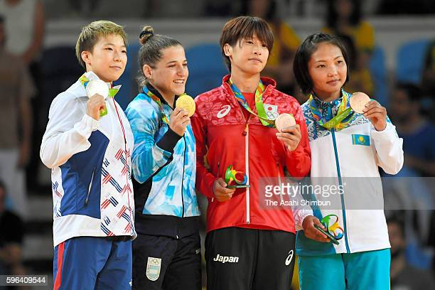 Silver medalist Bokyeong Jeong of Korea gold medalist Paula Pareto of Argentina bronze medalists Ami Kondo of Japan and Otgontsetseg Galbadrakh of...