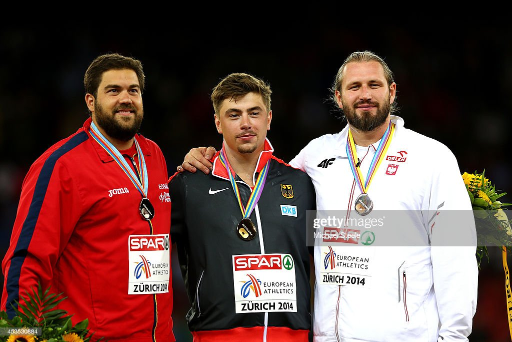 Silver medalist Borja Vivas of Spain, gold medalist David Storl of Germany and bronze medalist Tomasz Majewski of Poland stand on the podium during the medal ceremony for the Men's Shot Put final during day one of the 22nd European Athletics Championships at Stadium Letzigrund on August 12, 2014 in Zurich, Switzerland.