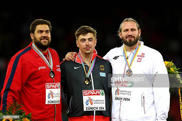 Silver medalist Borja Vivas of Spain gold medalist David Storl of Germany and bronze medalist Tomasz Majewski of Poland stand on the podium during...