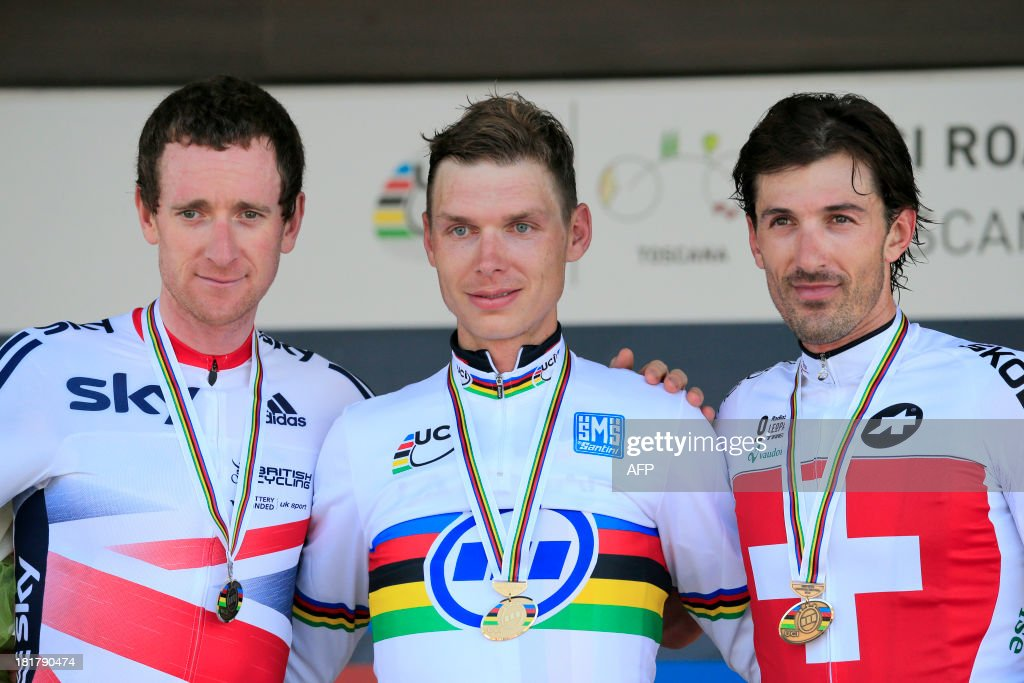 Silver medalist Bradley Wiggins of Great Britain, gold medalist Tony Martin of Germany and bronze medalist Fabian Cancellara of Switzerland pose on the podium of the Elite Men's Time Trial of the UCI Road World Championships on September 25, 2013 in Florence, Italy.