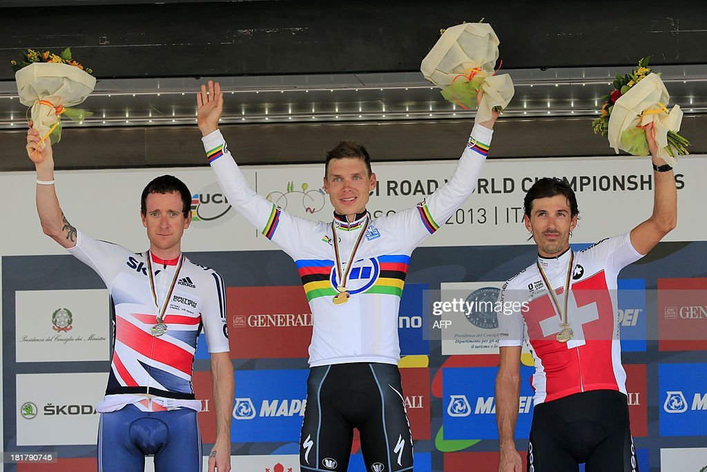 Silver medalist Bradley Wiggins (L) of Great Britain, gold medalist Tony Martin (C) of Germany and bronze medalist Fabian Cancellara of Switzerland pose on the podium of the Elite Men's Time Trial of the UCI Road World Championships on September 25, 2013 in Florence, Italy.