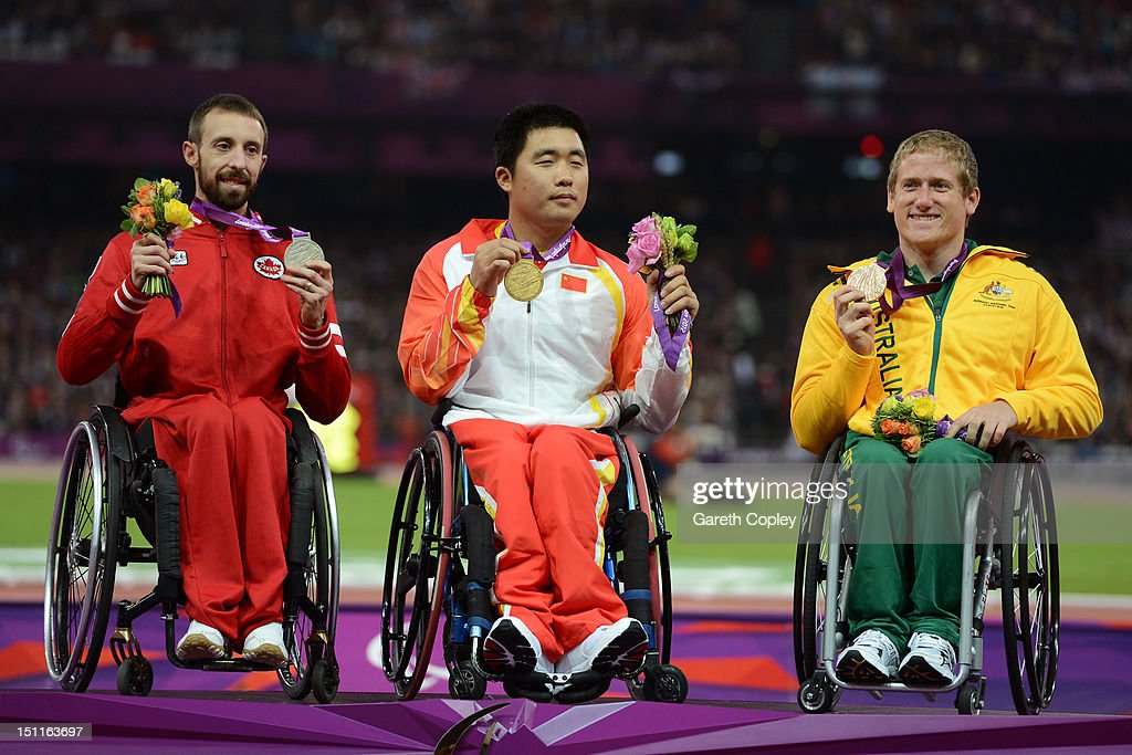 Silver medalist Brent Lakatos of Canada, gold medalist Huzhao Li of China and bronze medalist Richard Colman of Australia pose on the podium during the medal ceremony for the Men's 400m - T53 on day 4 of the London 2012 Paralympic Games at Olympic Stadium on September 2, 2012 in London, England.