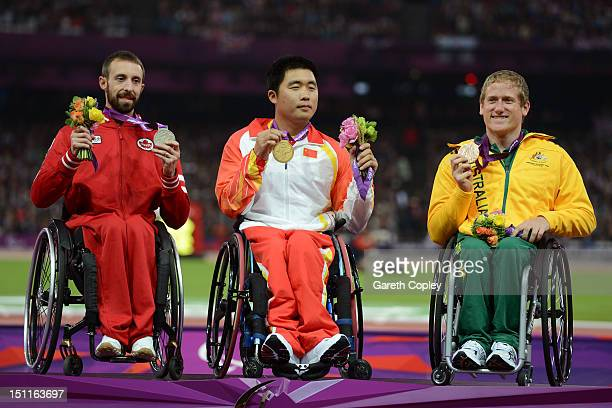 Silver medalist Brent Lakatos of Canada gold medalist Huzhao Li of China and bronze medalist Richard Colman of Australia pose on the podium during...
