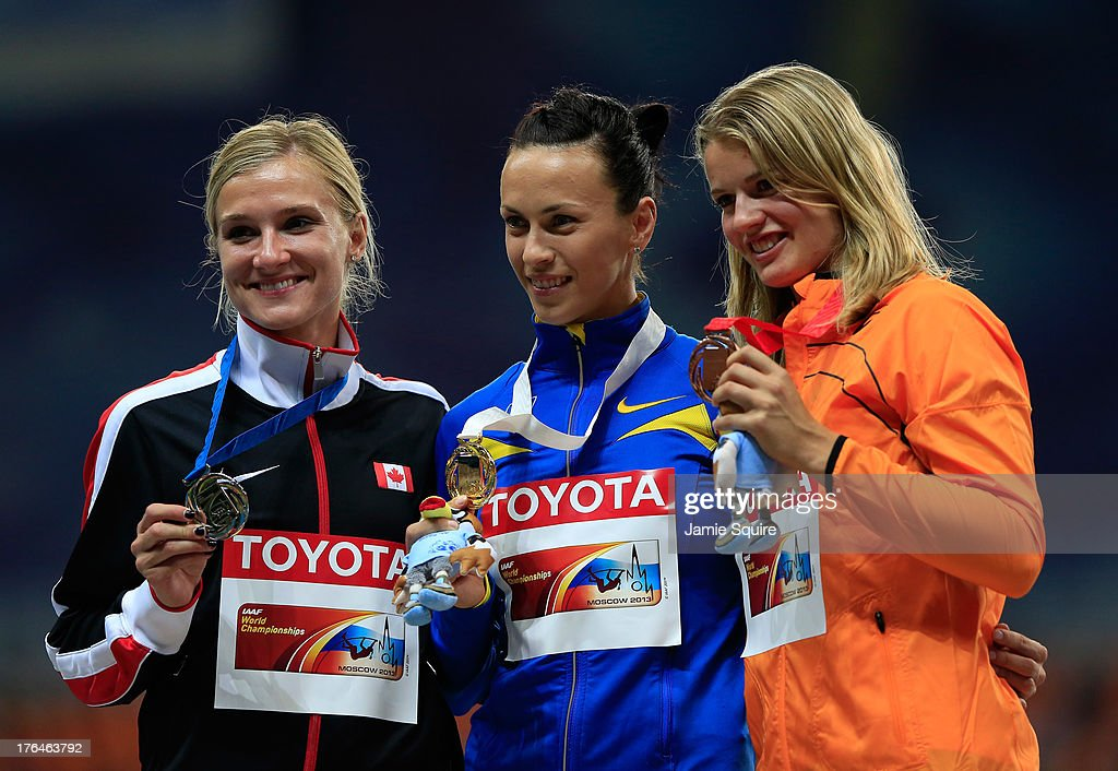Silver medalist Brianne Theisen Eaton of Canada, gold medalist <a gi-track='captionPersonalityLinkClicked' href=/galleries/search?phrase=Hanna+Melnychenko&family=editorial&specificpeople=1424232 ng-click='$event.stopPropagation()'>Hanna Melnychenko</a> of Ukraine and bronze medalist <a gi-track='captionPersonalityLinkClicked' href=/galleries/search?phrase=Dafne+Schippers&family=editorial&specificpeople=7115446 ng-click='$event.stopPropagation()'>Dafne Schippers</a> of the Netherlands stand on the podium during the medal ceremony for the Women's heptahlon during Day Four of the 14th IAAF World Athletics Championships Moscow 2013 at Luzhniki Stadium on August 13, 2013 in Moscow, Russia.