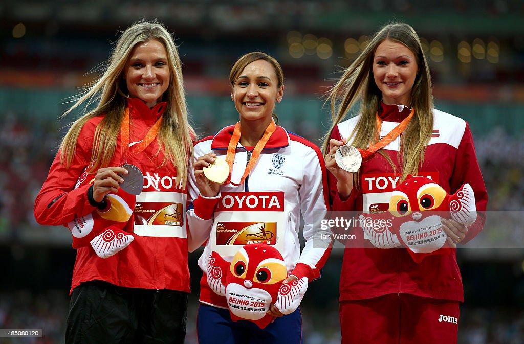 Silver medalist Brianne Theisen Eaton of Canada gold medalist Jessica EnnisHill of Great Britain and bronze medalist Laura IkaunieceAdmidina of...