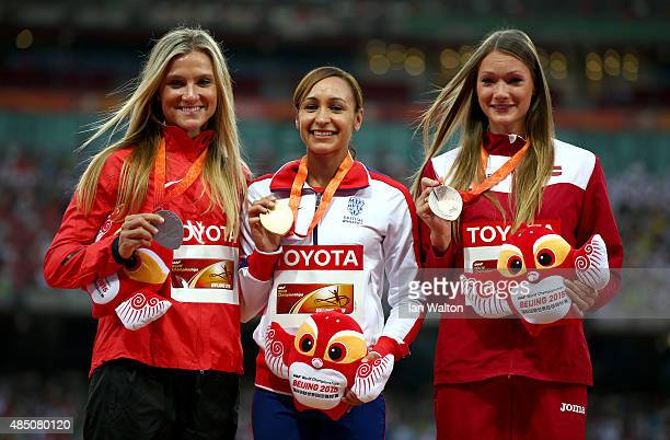 Silver medalist Brianne Theisen Eaton of Canada gold medalist Jessica EnnisHill of Great Britain and bronze medalist Laura IkaunieceAdmidina of...