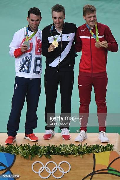 Silver medalist Britain's Mark Cavendish gold medalist Italy's Elia Viviani and bronze medalist Denmark's Lasse Norman Hansen pose on the podium...