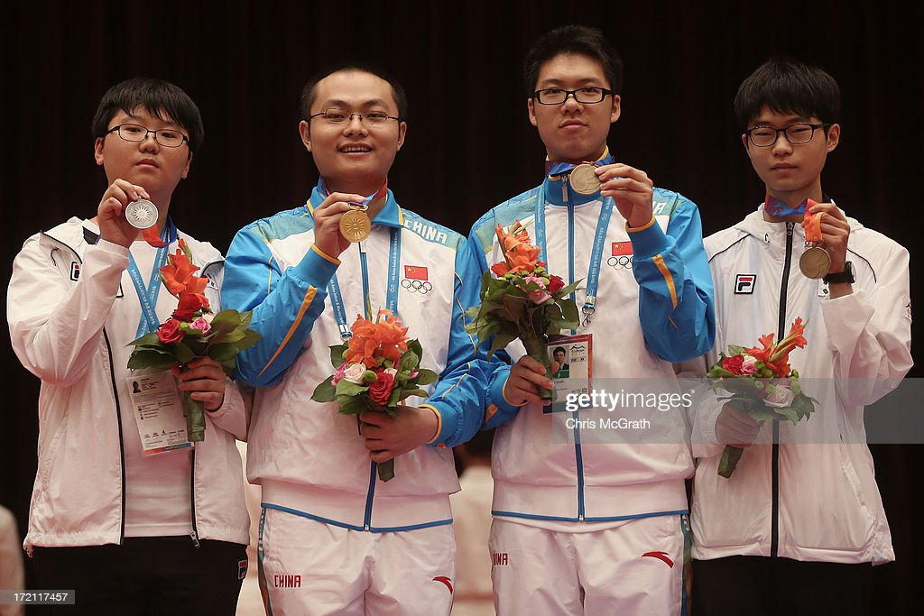 Silver medalist Byeon Sangil of Korea, Gold medalist Tang Weixing of China and Bronze medalists Tan Xiao of China and Lee Donghun of Korea pose with their medals during the victory ceremony for the Baduk(GO), Men's Individual Gold Medal Match at Yonsei University International Campus during day four of the 4th Asian Indoor & Martial Arts Games on July 2, 2013 in Incheon, South Korea.