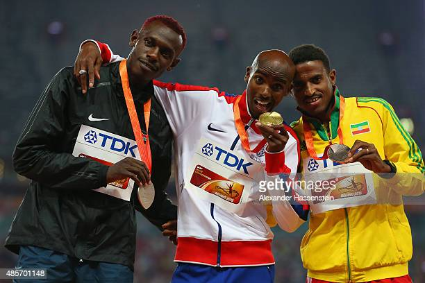Silver medalist Caleb Mwangangi Ndiku of Kenya gold medalist Mohamed Farah of Great Britain and bronze Hagos Gebrhiwet of Ethiopia pose on the podium...