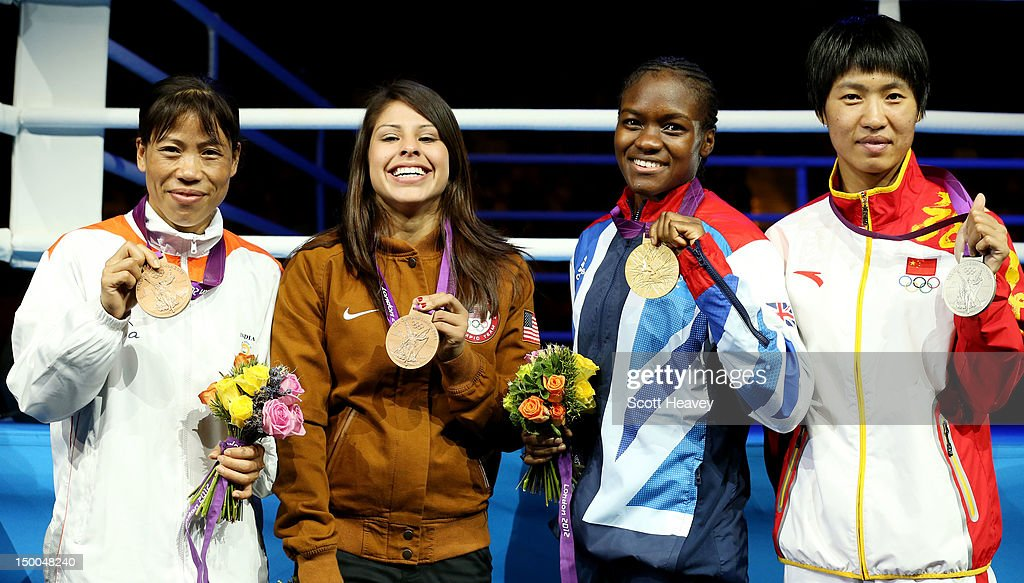 Silver medalist Cancan Ren (R) of China, gold medalist <a gi-track='captionPersonalityLinkClicked' href=/galleries/search?phrase=Nicola+Adams&family=editorial&specificpeople=9403811 ng-click='$event.stopPropagation()'>Nicola Adams</a> (2nd R) of Great Britain, bronze medalist Chungneijang Mery Kom Hmangte (L) of India and bronze medalist <a gi-track='captionPersonalityLinkClicked' href=/galleries/search?phrase=Marlen+Esparza&family=editorial&specificpeople=8936940 ng-click='$event.stopPropagation()'>Marlen Esparza</a> (2nd L) of the United States pose during the medal ceremony for the Women's Fly (51kg) Boxing final bout on Day 13 of the London 2012 Olympic Games at ExCeL on August 9, 2012 in London, England.