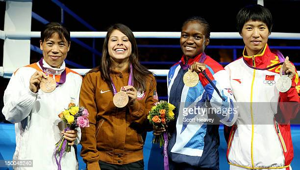 Silver medalist Cancan Ren of China gold medalist Nicola Adams of Great Britain bronze medalist Chungneijang Mery Kom Hmangte of India and bronze...