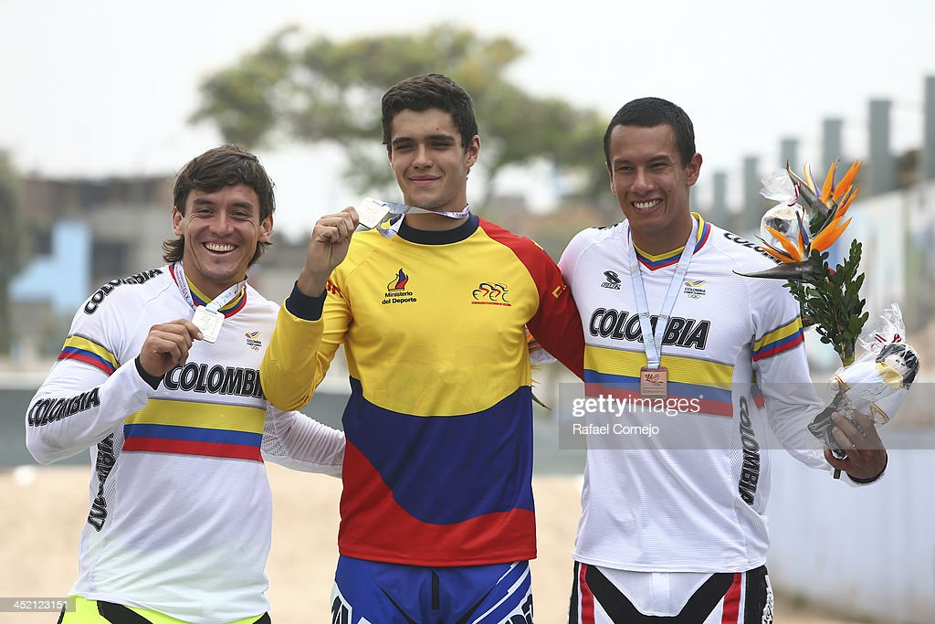Silver medalist Carlos Oquendo of Colombia, gold medalist Alfredo Campo of Ecuador and Bronze medalist <a gi-track='captionPersonalityLinkClicked' href=/galleries/search?phrase=Andres+Jimenez&family=editorial&specificpeople=5498155 ng-click='$event.stopPropagation()'>Andres Jimenez</a> in BMX as part of the XVII Bolivarian Games Trujillo 2013 at Huaricocha on November 26, 2013 in Lima, Peru.