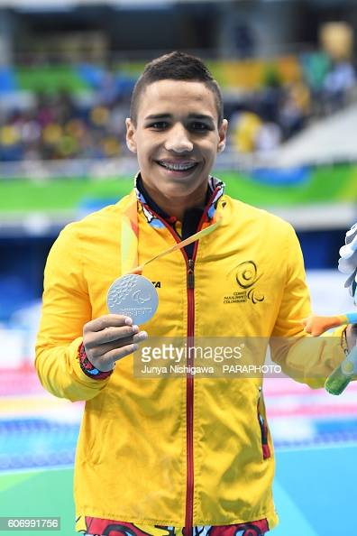 Silver medalist Carlos Serrano Zarate of Colombia celebrates on the podium at the medal ceremony for the Men's 100m Freestyle S7 Final on day 9 of...