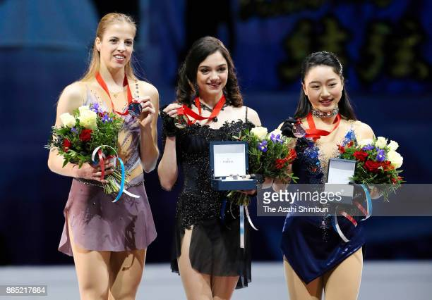 Silver medalist Carolina Kostner of Italy gold medalist Evgenia Medvedeva of Russia and bronze medalist Wakaba Higuchi of Japan pose on the podium at...