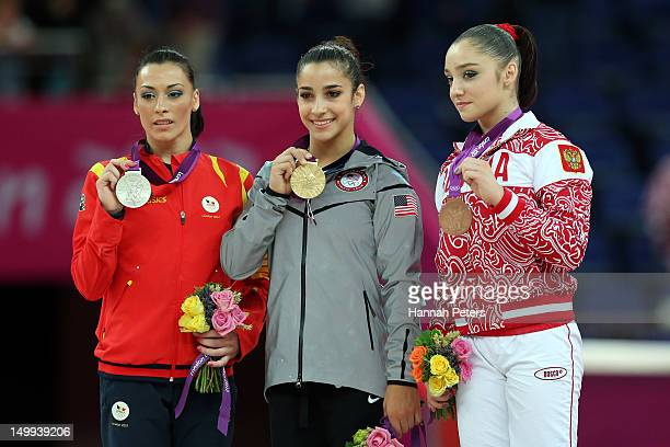 Silver medalist Catalina Ponor of Romania gold medalist Alexandra Raisman of the United States of America and bronze medalist Aliya Mustafina of...