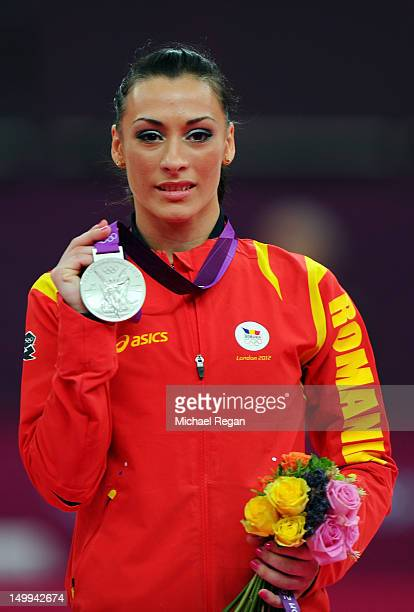 Silver medalist Catalina Ponor of Romania poses on the podium during the medal ceremony for the Artistic Gymnastics Women's Floor Exercise final on...