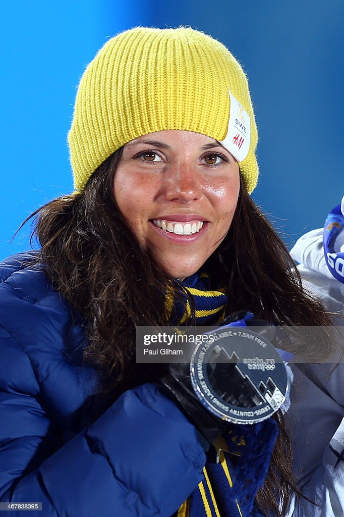 Silver medalist Charlotte Kalla of Sweden celebates on the podium during the medal ceremony for the for the for the Women's Skiathlon 7.5km Classic & 7.5km Free during day 1 of the Sochi 2014 Winter Olympics at Medals Plaza on February 8, 2014 in Sochi, Russia.
