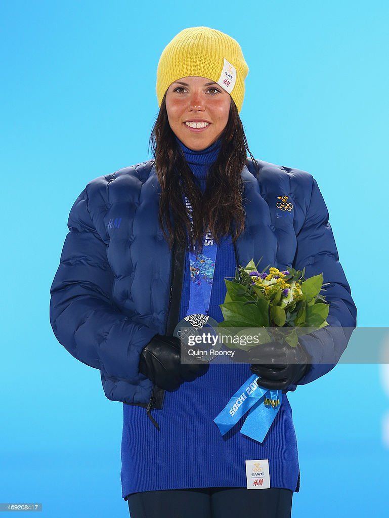 Silver medalist <a gi-track='captionPersonalityLinkClicked' href=/galleries/search?phrase=Charlotte+Kalla&family=editorial&specificpeople=4081474 ng-click='$event.stopPropagation()'>Charlotte Kalla</a> of Sweden celebrates during the medal ceremony for the Women's 10 km Classic on day six of the Sochi 2014 Winter Olympics at Medals Plaza on February 13, 2014 in Sochi, Russia.